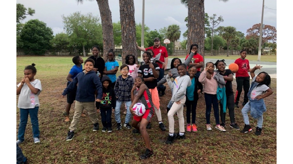 Florida firestone complete auto care employee with boys and girls club kids