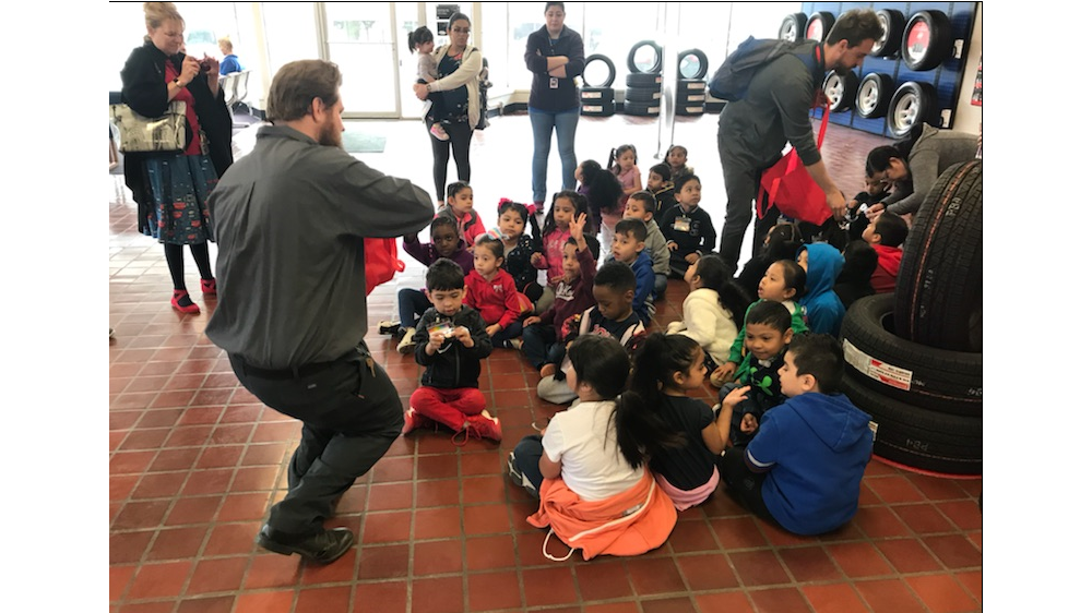 Firestone complete auto care teammates teaching children about tires