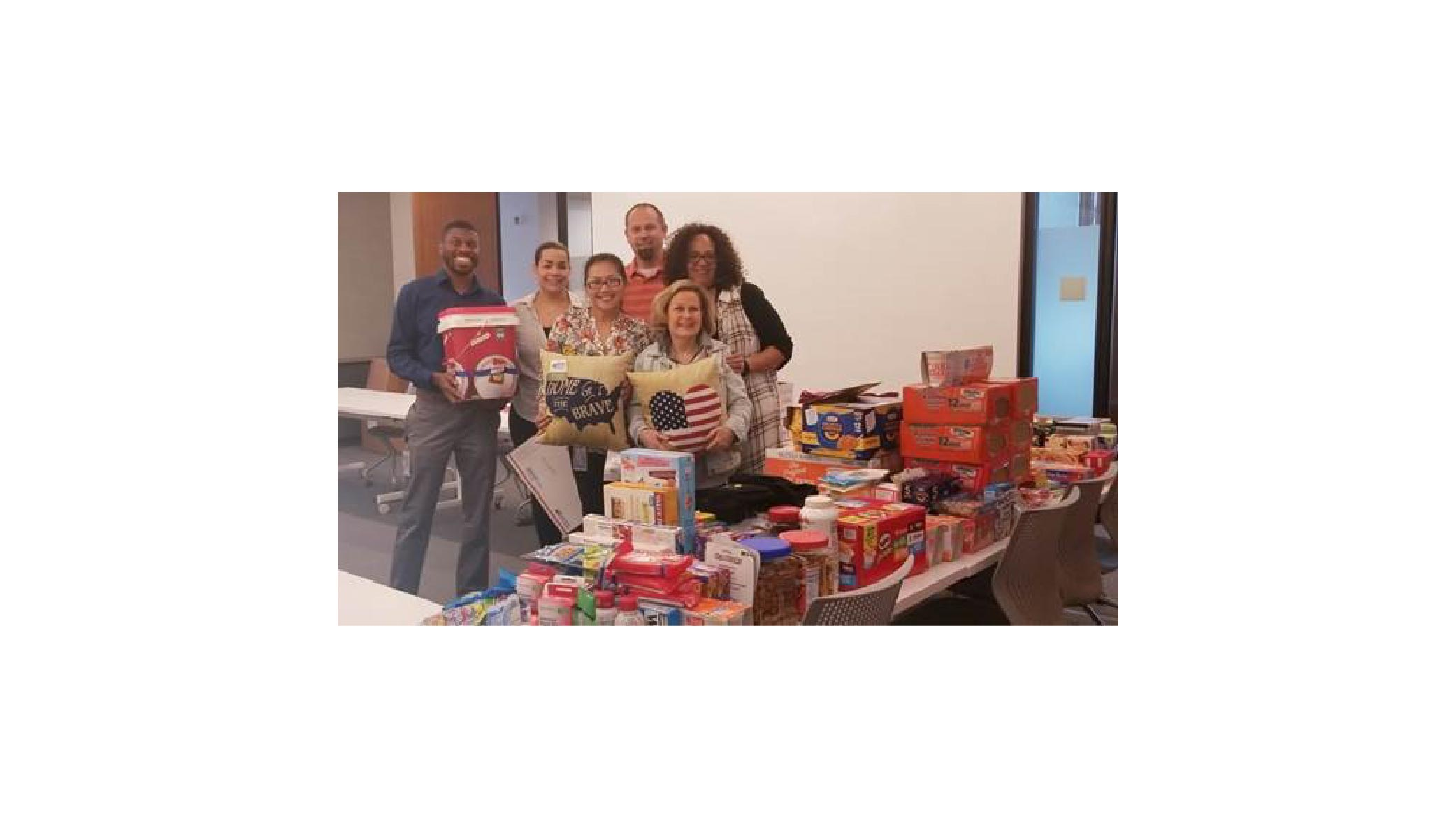 Firestone Building Products collect items for millitary members