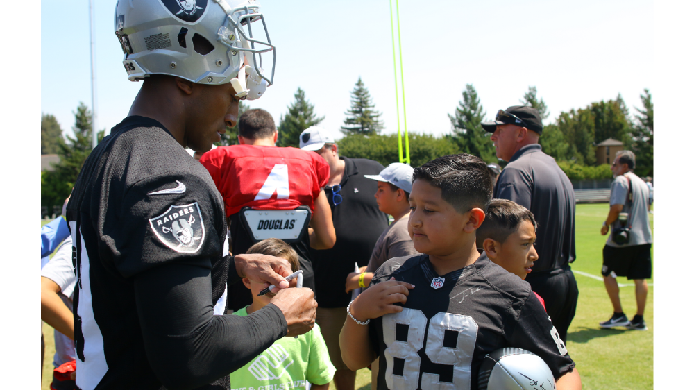 NFL players welcome boys and girls club kids to camps