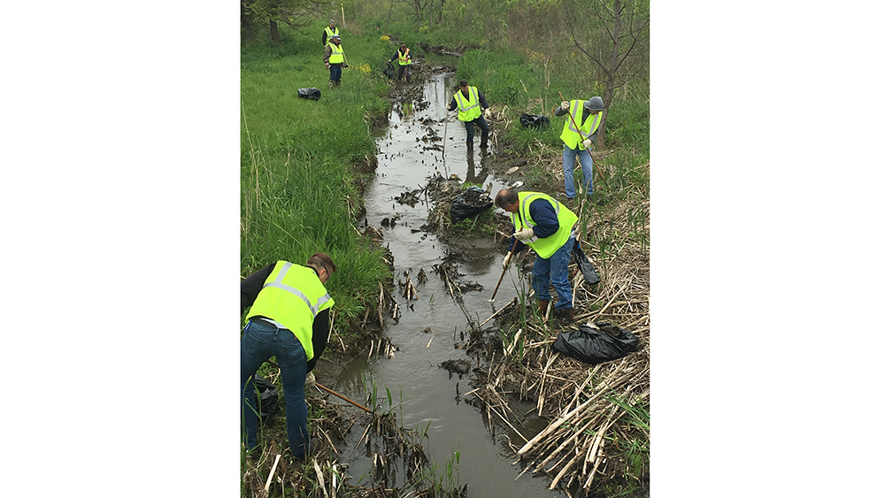 Bridgestone Bloomington, IL teammates clean up creek