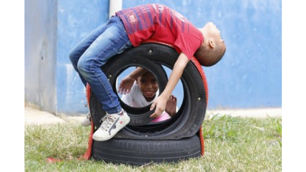 Children playing at Bridgestone Environmental Education Project in Brazil
