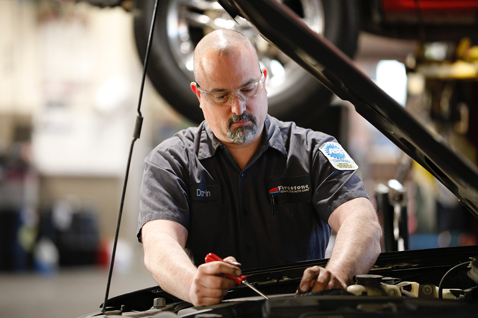 Darin Stalker working on car for Bridgestone Retail Operations